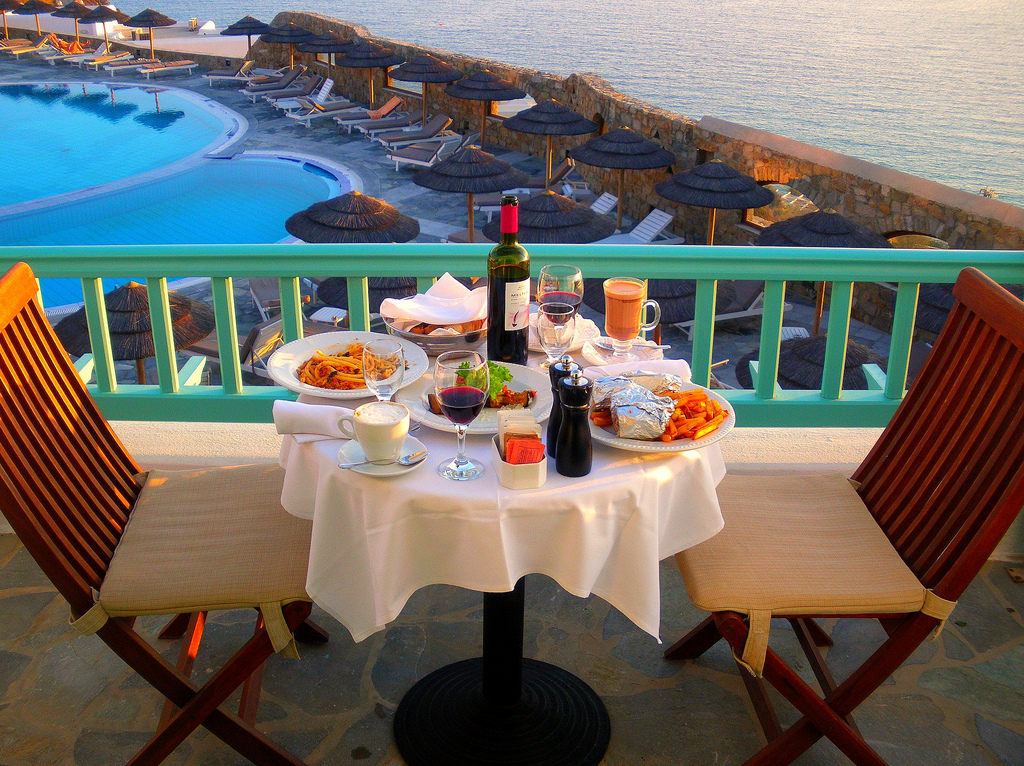 Our Dinner for two with pool and sea views at our balcony in the Royal Myconian Hotel in Elia Beach, Mykonos